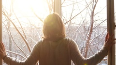 Young woman openning windows on a sunny winter day Stock Footage