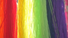 Colourful Wool Threads Blowing in the Wind Background Stock Footage