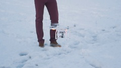 A man controls a drone at winter garden Stock Footage