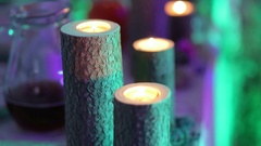 Burning candles on wooden stumps in the wedding decor. Stock Footage