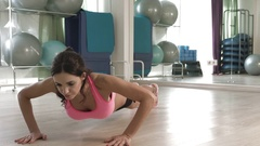 Strong woman doing push-ups on the floor. Stock Footage