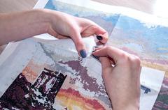 Female hand embroidered cross-stitch pattern under the scheme Stock Photos