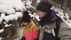 Young man and woman in winter clothing walk together holding hands in winter Stock Footage