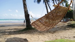 View from an hammock near ocean beach Stock Footage