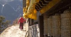 Buddhist Monk Spinning Prayer Wheels Stock Footage
