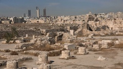Contrast between the old decaying Citadel ruins and modern skyline of Amman Stock Footage