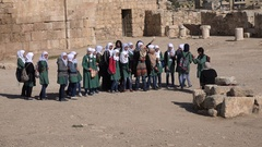 Middle Eastern Muslim school girls visit monument in Amman, Jordan Stock Footage