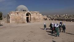 Veiled Muslim school girls visit palace of Citadel ruins in Amman, Jordan Stock Footage