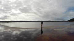 Reflection of male walking next to perched lake on Fraser Island Stock Footage