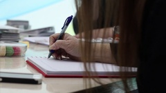 Woman taking notes on notepad in a meeting Stock Footage