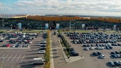 Big parking lot full of cars near large exhibition center Stock Footage