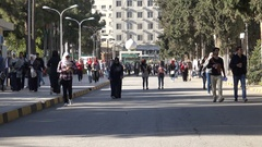 Students walk across the campus of the University of Jordan in Amman Stock Footage