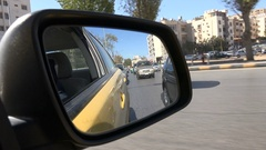 Driving through slow traffic in Amman, view from the mirror Stock Footage