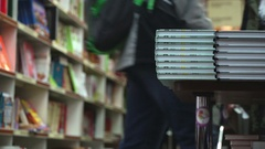 Concept learning and knowledge. Bookstore shelves with book stacks in bookstore Stock Footage