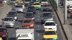 Commuting traffic drives across busy road in Amman, Middle East Stock Footage