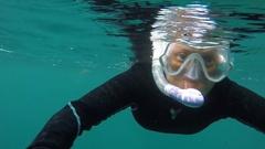 Female Snorkeler Swimming Toward Camera Stock Footage