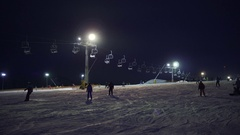 Operation of the surface lift in winter during night skiing time. Night skiing Stock Footage