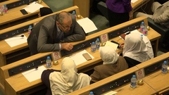 Female Muslim politicians wearing headscarves in parliament Jordan Stock Footage