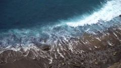 Sea waves beat against the stone beach Stock Footage