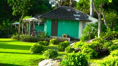 Single-storey tourist houses immersed in the greenery on the island Stock Footage