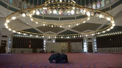 Muslim men pray inside the King Abdullah mosque in Amman Stock Footage