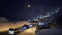 BUKOVEL, UKRAINE - December 26: Traffic at the road from the resort at night Stock Footage