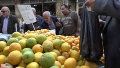 Vendor sells fresh oranges at fruit vegetable market Amman Jordan Stock Footage