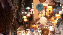 People who regard Christmas globes exposed to stall in the Christmas F Stock Footage