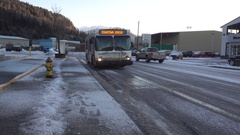 City Bus Pulling to Stop In Juneau Alaska Stock Footage