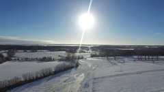 Aerial view  fly over beautiful snowy landscape with sun and blue sky in germany Stock Footage