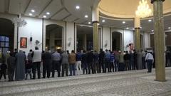 Men pray at a community mosque in Amman, Jordan Stock Footage