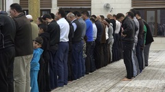 Islamic religion Middle East, men pray in mosque Amman Jordan Stock Footage