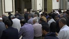 Muslims pray inside a mosque in Amman, Jordan Stock Footage