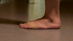 Female ballet dancer stretching and warming up before dance practice. Stock Footage