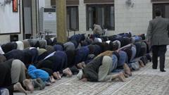 Muslim men pray inside a mosque in Amman, Jordan Stock Footage