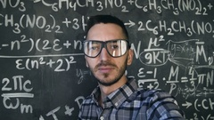 Young scientist man making selfie shoot in chemical and mathematical equations Stock Footage