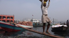 Manual laborers carry bricks in Dhaka, employment developing world Stock Footage