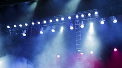 Lighting equipment on the stage. Smoke and blue and red spotlights Stock Footage