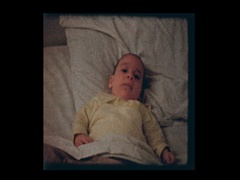 2 month old infant boy in big brothers bed Stock Footage