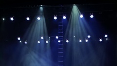 Theatrical equipment on stage: spotlights, scanners, head, smoke Stock Footage