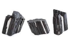 Mineral of black tourmaline in white background Stock Photos