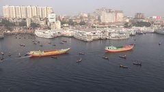 Busy Buriganga river and skyline of Dkaha city in Bangladesh Stock Footage