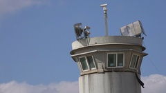 Lights and security cameras on watchtower separation wall West Bank Stock Footage