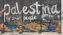 Colorful graffiti art on the security barrier West Bank Stock Footage