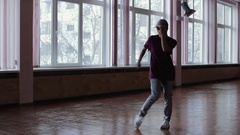 A female professional break dancer performing in the dance studio Stock Footage