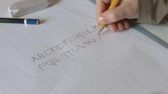 Child writing alphabet letters XYZ Stock Footage