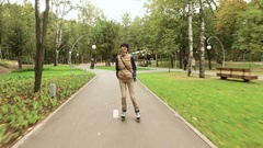 Roller skates. Female roller-skater practicing inline skating in the park. 4K Stock Footage