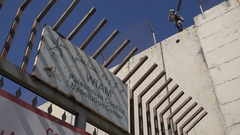 Entrance to a 'Palestinian Conflict Resolution Center' at separation wall Stock Footage