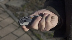 Switchblade Automatic Knife, Opening Blade, Slow Motion Stock Footage