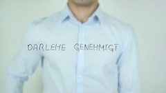 Darlehen genehmigt, Loan Approved in German Writing on Glass Stock Footage